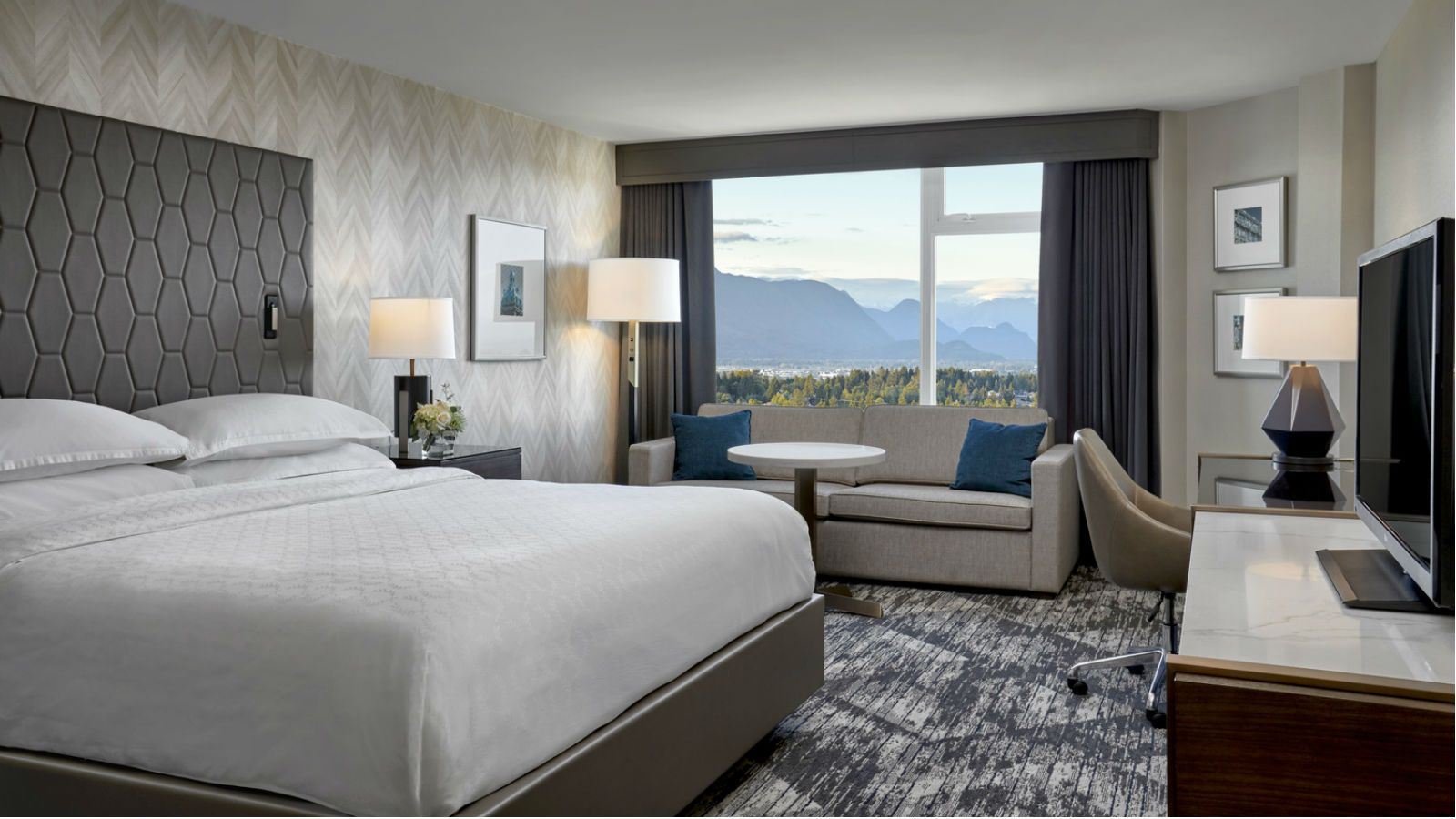 A traditional room at the Sheraton Vancouver Guildford, complete with mountain views.